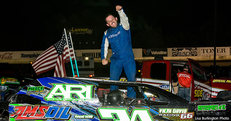 Mark Schafman celebrates after winning the USRA Modified feature.