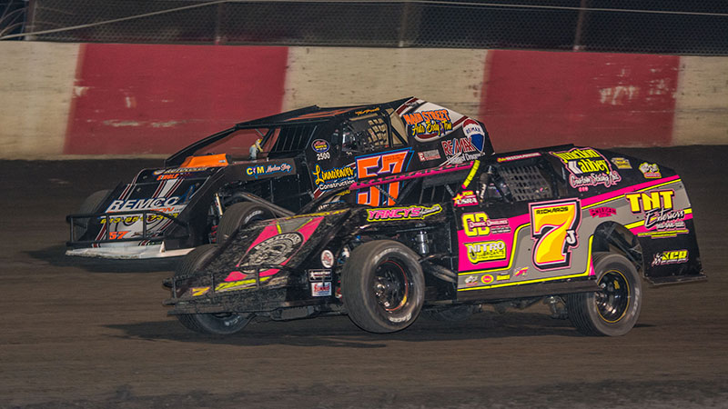 Tim Powell (57) and Jake Richards (7J) battle during last Friday's Out-Pace USRA B-Mod main event. (Lisa Burlington Photo)