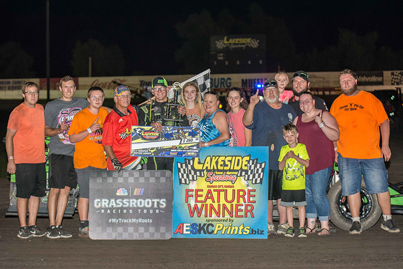 Trevor Hand celebrates E-Mod Explosion victory at Lakeside Speedway (Photo by Lisa Burlington)